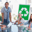 Team having meeting about recycling — Stock Photo #25725521