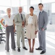 Royalty-Free Stock Photo: Smiling business people standing in line