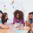 Creative team going over contact sheets in meeting — Stock Photo