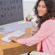 Stock Photo: Happy editor at her desk
