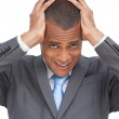 Exhausted businessman holding his head between hands — Stock Photo