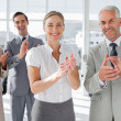 Smiling business applauding together — Stockfoto #25726423