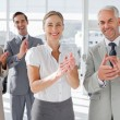 Stock Photo: Smiling business applauding together
