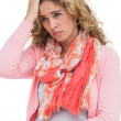 Stock Photo: Blonde woman having both headache and belly pain