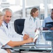 Two smiling doctors using laptop — Stock Photo