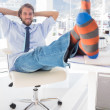 Shoeless designer kicking back — Stock Photo