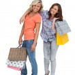 Two friends holding shopping bags — Stock Photo #25726607