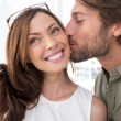Man kissing pretty woman on the cheek — Stock Photo