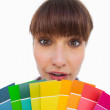 Pretty woman with fringe showing colour charts close up — Stock Photo #25726877