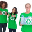 Stock Photo: Smiling activist holding recycling box