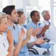 Medical team clapping hands — Foto Stock #25726933