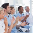 Stock Photo: Medical team clapping hands