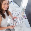 Stock Photo: Photo editor holding contact sheet