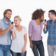 Stock Photo: Fun group at karaoke
