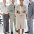 Attractive businesswoman standing in front of colleagues — Stock Photo #25727577