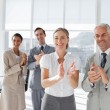 Group of business applauding together — Foto Stock #25727779