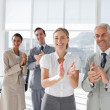 Foto Stock: Group of business applauding together