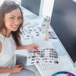 Happy designer holding contact sheet — Stock Photo