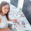 Stock Photo: Pretty editor with contact sheet