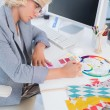Interior designer looking at colour charts — Stock Photo