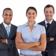 Foto Stock: Small group of smiling business standing together
