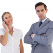 Smiling businesswoman on the phone next to her colleague — Stock Photo