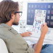 Photo editor examining contact sheet — Stock Photo