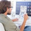 Photo editor examining contact sheet — Stock Photo