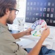 Editor looking at colour wheel — Stock Photo