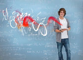 Student posing in front of chalk board — Stock Photo
