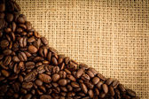 Coffee beans and burlap sack — Stock Photo