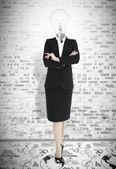 Businesswoman with head light bulb — Stock Photo