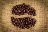 Coffee beans formed into shape — Stock Photo