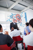 Business clapping stakeholder standing in front of blue m — Stock Photo