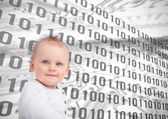 Baby sitting in front of binary codes — Stock Photo