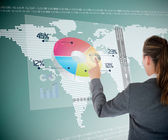 Businesswoman using colorful transparent futuristic interface — Stock Photo