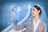 Smiling businesswoman using blue pie chart interface — Stock Photo