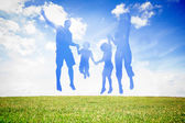 Silhouette of family jumping in the air — Stock Photo