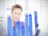 Businessman looking at blue chart interface — Stock Photo