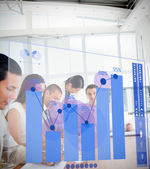 Group of colleagues using blue chart interface — Stock Photo