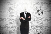 Businesswoman and light bulb — Stock Photo