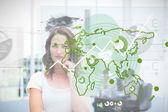 Blonde businesswoman using green map interface — Stock Photo