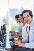 Joyful call centre agent working — Stock Photo