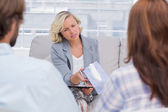 Therapist giving tissue to a woman — Stock Photo