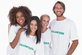 Smiling group of volunteers — Stock Photo