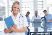 Young nurse holding file — Stock Photo