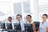 Line of call centre employees smiling — Stock Photo