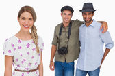 Pretty woman smiling with her friends behind her — Stock Photo