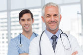 Two smiling doctors standing — Stock Photo