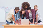 Creative team looking at laptop — Stock Photo